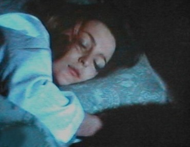 She tiptoed down to the bedroom to find his mother lying all over her side of the bed and clutching her pillow...