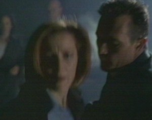 'How bad is he?' she asked again, struggling in Doggett's arms...